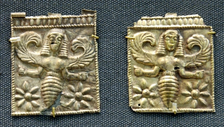 Gold plaques embossed with winged bee goddesses, perhaps the Thriai, found at Camiros Rhodes, dated to 7th century BCE (British Museum)